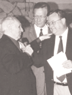 From the July 11, 2002 Baptist Messenger: HONORED: Royce Brown, left, Music Minister Emeritus at Sapulpa, First, accepts congratulations from Ron Fannin, Associate Executive Director of the Baptist General Convention of Oklahoma, right, and Bill Green, BGCO Associate Executive Director of Church and Family Equipping Ministries and Director of The Singing Churchmen of Oklahoma, of which Brown is a charter member. Brown was honored by Sapulpa, First, for more than 50 years of ministry. Fannin presented an award from the BGCO Historical Commission, and Green announced the establishment of the Royce Brown Award for Lifetime Achievement in Music Ministry.